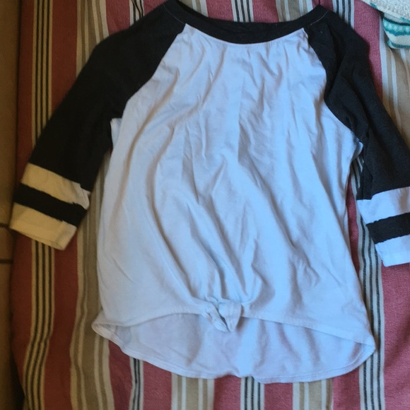 SO Other - A t shirt that is white and has black sleeves